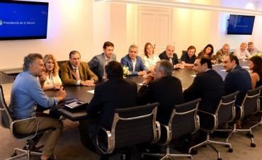 Lordén con autoridades de la UCR  junto al Presidente Macri