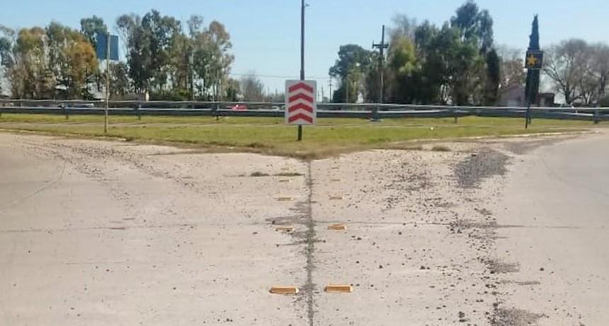 Colocación de tachas en la rotonda de Eva Perón y Avellaneda